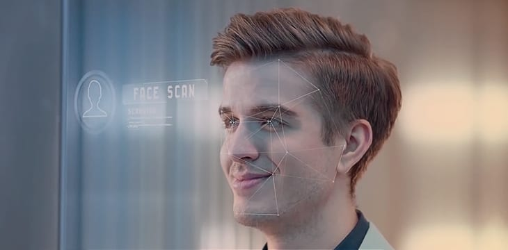 Facial recognition software scans a young mans smiling face