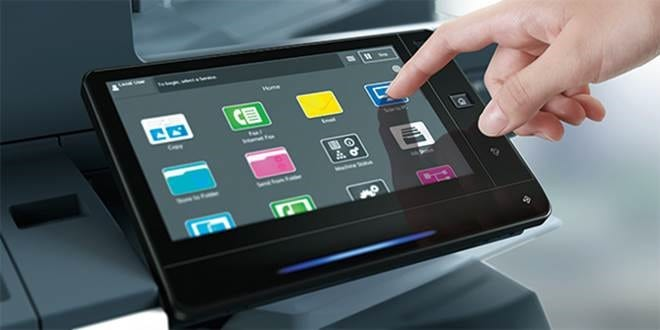 Xerox ApeosPort-VII & DocuCentre-VII touchscreen with hand pointing at apps