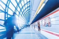 Blurry man on train platform at airport with bright light